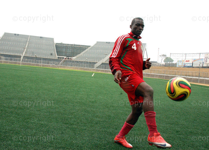 Malawi's rising Soccer Star and 2008 footballer of the year Chiukepo Msowoya plays with the ball at Kamuzu Stadium October 29, 2009 during preparatory training for COSAFA games scheduled for October 31, 2009 in Zimbabwe.