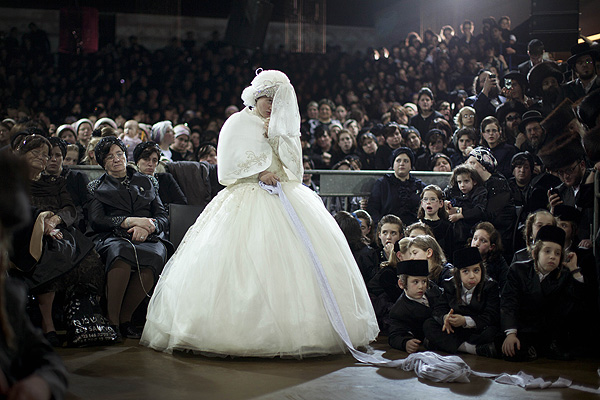 An Ultra Orthodox Wedding. This story was awarded a silver medal in the category of  Daily Life (Stories). Ultra-Orthodox Jewish bride Nechama Paarel Horowitz fulfills the Mitzvah tantz during her traditional Jewish wedding to Chananya Yom Tov Lipa, the great-grandson of the Rabbi of the Wiznitz Hasidic followers, in the Israeli town of Petah Tikva near Tel Aviv, Israel, Early Wednesday, Feb. 15, 2012. The Mitzvah tantz, has family members and honored rabbis invited to dance in front of the bride, often holding a gartel, and then dancing with the groom. PHOTO: Oded Balilty/Associated Press