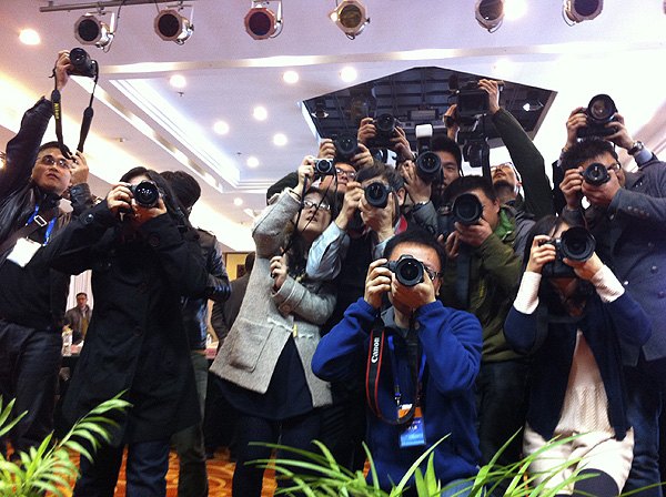 Chinese press photographers take images of the judging panel at the 9th China International Press Photo Contest. PHOTO: David Larsen/Africa Media Online