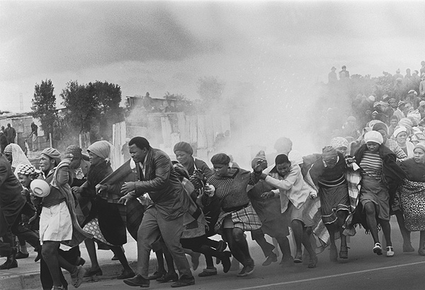 The World Press Photo of the Year 1977: Leslie Hammond (South Africa), The Argus; Police throw tear-gas at a group of chanting residents of the Modderdam squatter camp protesting against the demolition of their homes outside Cape Town