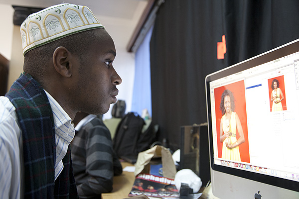 """Award-winning Kenyan photographer Boniface Mwangi in his studio in Nairobi, Kenya. While Boniface has won awards for his photojournalism, like many photographers, his bread and butter comes from work that fits more into the """"retail"""" genre. Most financially successful photographers have learnt to understand the markets for photography and place themselves and their work well within those markets."""