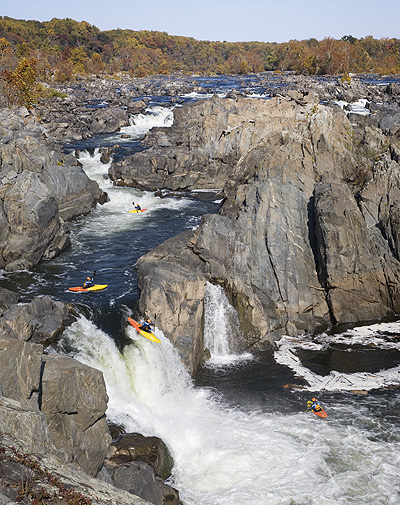 """Although it is made up of a number of photographs, that would be considered photographs if presented on their own, this composite image is likely to be considered a """"photo illustration"""" since it is illustrating something more than the simple reality of the moment. It was taken of a paddler on the Potomac River in Great Falls Park in northern Virginia near Washington DC. PHOTO: David A. Larsen"""