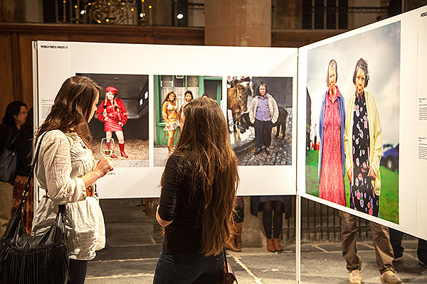 Guests at the opening of the World Press Photo exhibition 2011 view some of the images at Die Oude Kerk, Amsterdam.